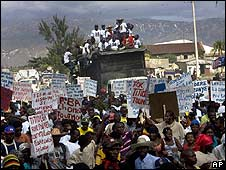 Supporters of ex-President Jean-Bertrand Aristide march in Port-au-Prince