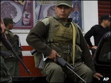 Soldiers and police officers patrol the slum of El Milagro, in Mixco, Guatemala, on 2 December