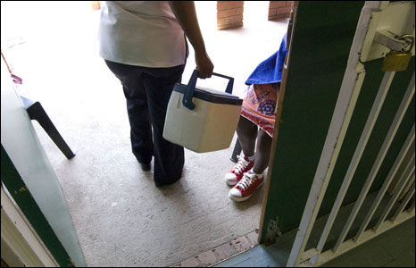 A nurse carries the TB drugs