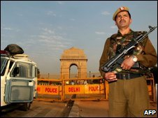 An Indian police officer stands guard at India Gate in New Delhi on December 17, 2008.