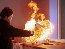 Stuntman demonstrates chip pan fire