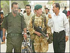 British soldiers on patrol with Iraqi police