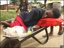 Zimbabwe cholera patient in wheelbarrow