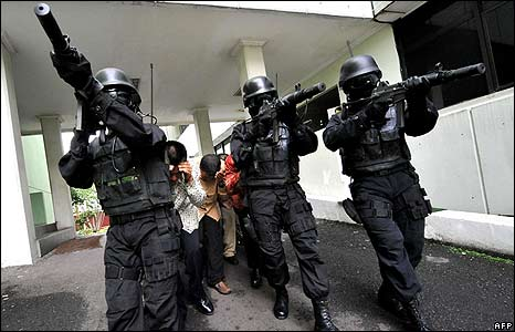 Indonesia's anti-terror squad evacuate hostages during a drill in Jakarta