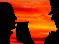 Silhouette of a police officer conducting a breath test