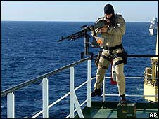 A member of the Dutch special forces guards a Dutch cargo ship as it passes near the Gulf of Aden (8 December)