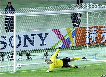 Van der Sar is unable to stop Endo's penalty
