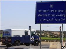 An armored vehicle containing Israeli currency enters the checkpoint before its transfer to Gaza at the Erez crossing