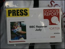 Judy the Duck wears her School Report press pass with pride.