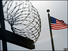 US flag flies above razor wire at the Guantanamo Bay detention centre