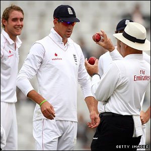 England captain Kevin Pietersen consults with umpire Daryl Harper