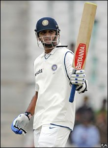 Rahul Dravid lifts his bat in celebration after reaching 50