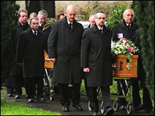 The coffins being taken into church