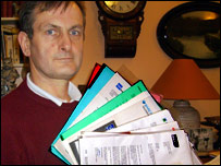 Chris Gray with his wife's financial documents