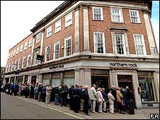 People queuing outside branch of Northern Rock