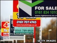 A row of for sale and to let signs