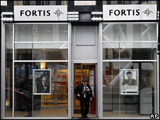 A man walks out of a branch of the Fortis bank in Brussels on 18 December 2008 