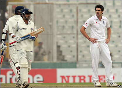James Anderson looks on as the Indian total increases
