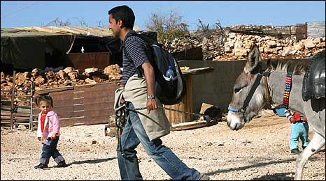 Aleem Maqbool leads his donkey