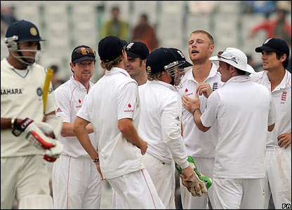 VVS Laxman (left) departs after falling lbw to Andrew Flintoff (bare-headed)