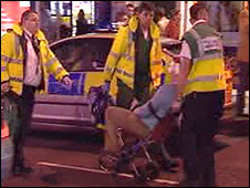 Ambulance staff take a patient in St Mary Street, Cardiff