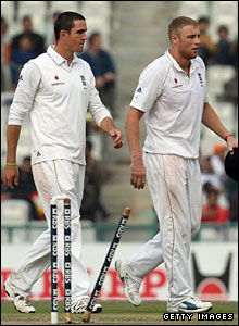 Kevin Pietersen and Andrew Flintoff walk off after India are bowled out