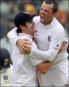 Graeme Swann celebrates a wicket in Mohali