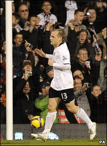 Danny Murphy wheels away leaving the ball in net after converting a controversial penalty