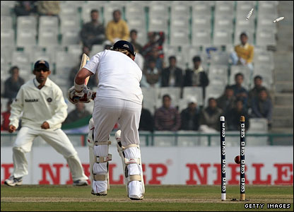 Ian Bell is clean bowled by Ishant Sharma