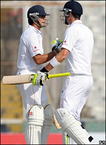 Alastair Cook is congratulated by Kevin Pietersen after reaching his fifty
