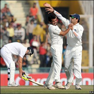 Zaheer Khan (centre) celebrates the dismissal of Alastair Cook (left) with Yuvraj Singh (right)
