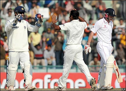 Mahendra Dhoni and Amit Mishra celebrate after combining to dismiss Paul Collingwood (right)