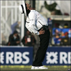 Umpire Asad Rauf stretches