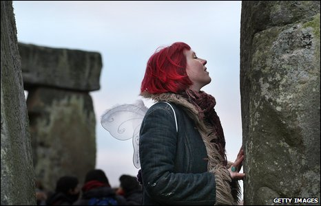 Woman with fairy wings at Stonehenge