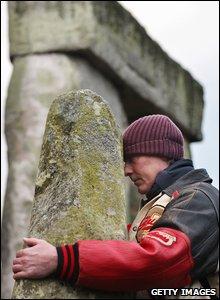 Man hugging a stone
