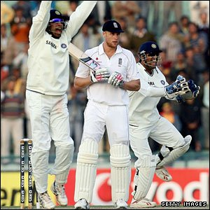 Andrew Flintoff is caught at short leg by Gautam Gambhir (not pictured)