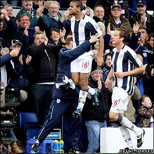 Moore celebrates his goal