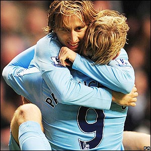 Modric celebrates with Roman Pavlyuchenko
