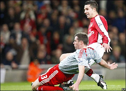 Van Persie gets his shot off before Jamie Carragher can intervene