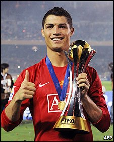 Cristiano Ronaldo, who made United's winning goal, with the trophy