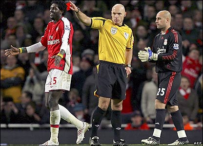 Referee Howard Webb sends off Adebayor