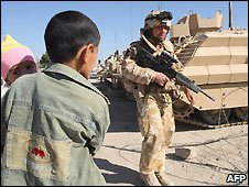 Iraqi boy and UK soldier in Basra, Iraq - 17/12/2008