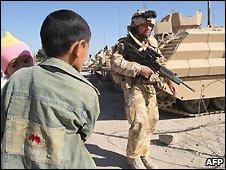 Iraqi boy and UK soldier in Basra, Iraq - 17/12/2008