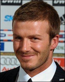 David Beckham poses during his official presentation at AC Milan on 20 December