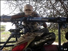 An armed militia man near Mogadishu, Somalia, on 11 December 2008