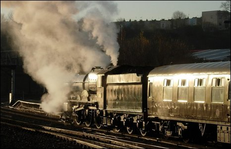 Steam train emitting steam