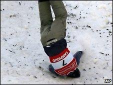 Skiier falls