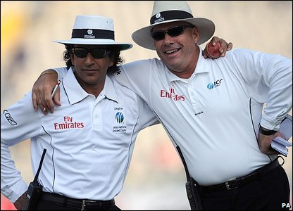 Umpires Asad Rauf (left) and Daryl Harper