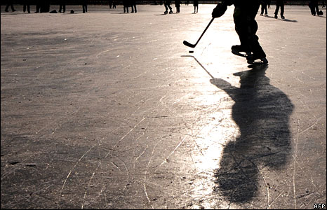 Hockey player on a frozen Beijing lake