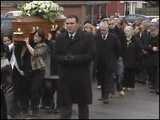 Mr McIlhone's remains being carried to the church